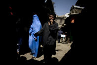 FILE - In this July 12, 2010 file photo, people walk through a market in downtown Kabul, Afghanistan.. (AP Photo/Rodrigo Abd, File)