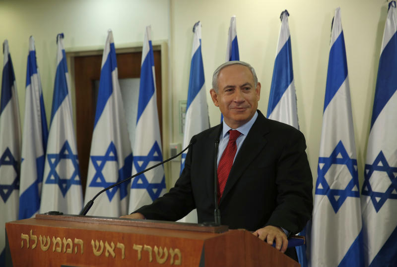 Israel's Prime Minister Benjamin Netanyahu pauses while delivering a statement at his office in Jerusalem, Wednesday, Jan. 23, 2013. A weakened Netanyahu scrambled Wednesday to keep his job by extending his hand to a new centrist party that advocates a more earnest push on peacemaking with the Palestinians and whose surprisingly strong showing broadsided him with a stunning election deadlock. (AP Photo/Darren Whiteside, Pool)