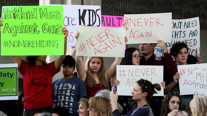 Protesters attend a rally at the Federal Courthouse in Fort Lauderdale, Fla., to demand government action on firearms, on Saturday, Feb. 17, 2018. Their call to action is a response the massacre at Marjory Stoneman Douglas High School in Parkland, Fla. (Photo: Mike Stocker/Sun Sentinel/TNS)