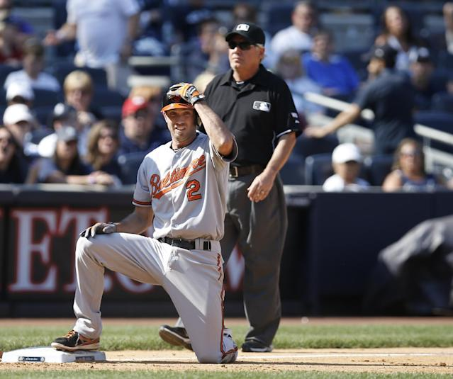 Baltimore Orioles' J.J. Hardy (2) rests at third after hitting a bases-clearing, eighth-inning double and advancing on the throw in a baseball game against the New York Yankees at Yankee Stadium in New York, Sunday, June 22, 2014. (AP Photo/Kathy Willens)