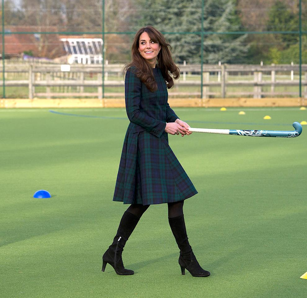 <p><b>When: November 30, 2012</b> <br /> Donning an Alexander McQueen green tartan coat while showing off her field hockey skills in a visit to St. Andrew's. </p>