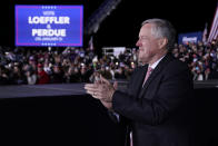White House chief of staff Mark Meadows listens as President Donald Trump speaks during a campaign rally for Sen. Kelly Loeffler, R-Ga., and David Perdue at Dalton Regional Airport, Monday, Jan. 4, 2021, in Dalton, Ga. (AP Photo/Evan Vucci)