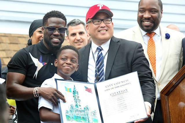 Kevin Hart pictured with son, Hendrix at Kevin Hart Day and birthday celebration and mural dedication in front of Max's Steaks in Philadelphia, Pa on July 6, 2017