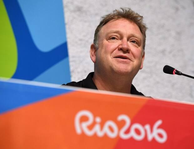 Swimming Canada's John Atkinson says risk of COVID variants has added to urgency of getting country's athletes vaccinated ahead of Tokyo Olympics. (Sean Kilpatrick/Canadian Press - image credit)