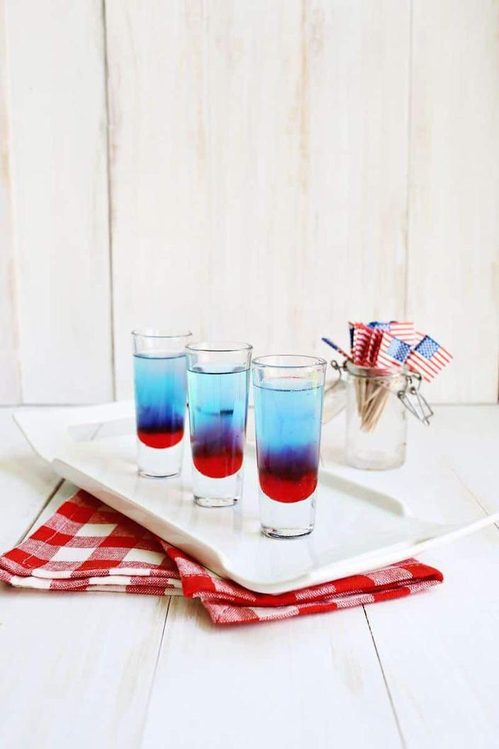 """<p>For the liveliest crowds, these layered shooters are guaranteed to keep the party interesting.</p><p> Get the <a href=""""https://abeautifulmess.com/bomb-pop-shots/"""" rel=""""nofollow noopener"""" target=""""_blank"""" data-ylk=""""slk:recipe"""" class=""""link rapid-noclick-resp"""">recipe</a>. </p>"""