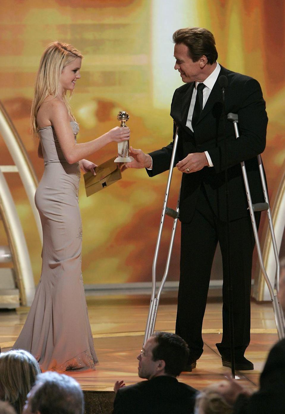 "<p>Yup, that's Jack Nicholson's daughter to the left of Arnold Schwarzenegger as he accepts his Golden Globe. How'd she land such a high-profile job? She was named 2007's <a href=""https://www.townandcountrymag.com/leisure/arts-and-culture/g25734384/best-miss-golden-globes-ambassadors-ever/?"" rel=""nofollow noopener"" target=""_blank"" data-ylk=""slk:Miss Golden Globe"" class=""link rapid-noclick-resp"">Miss Golden Globe</a>, a position given to the child of a different celebrity each year.</p>"