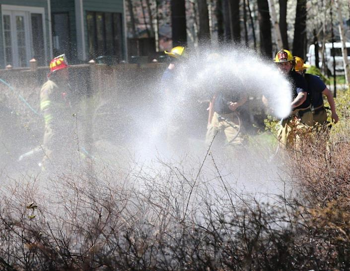 Dover, NH firefighters were able to quickly extinguish a two-alarm brush fire on April 26, 2021.