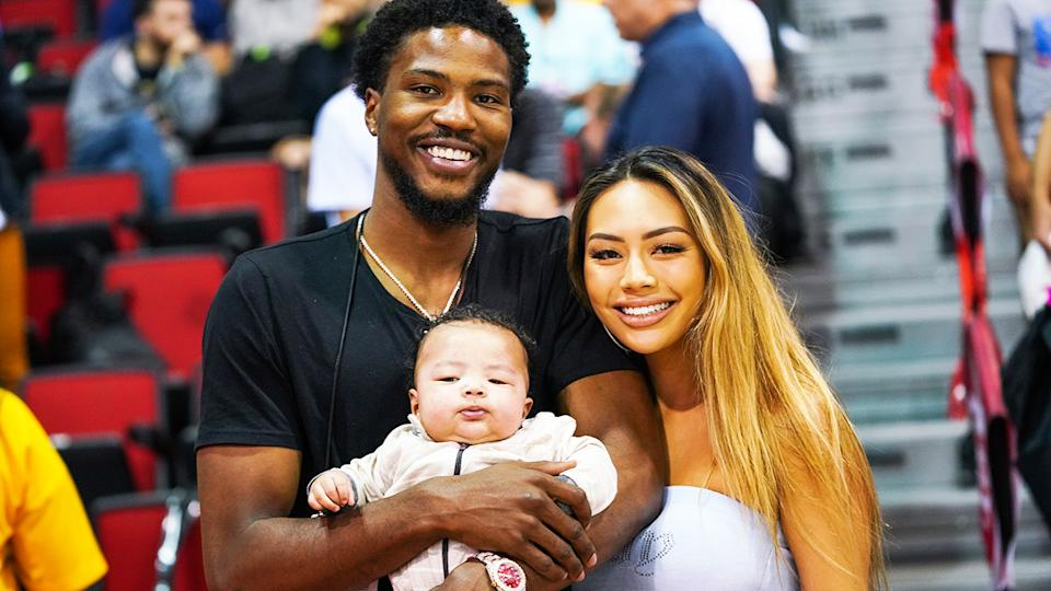 Malik Beasley, pictured here with Montana Yao and their son Makai in 2019.