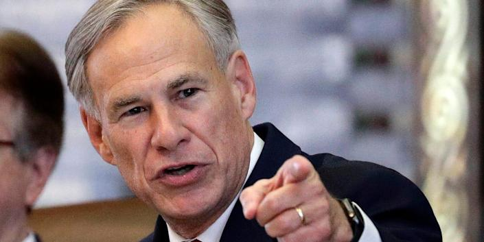 Texas Governor Greg Abbot points at the camera with a stern expression.