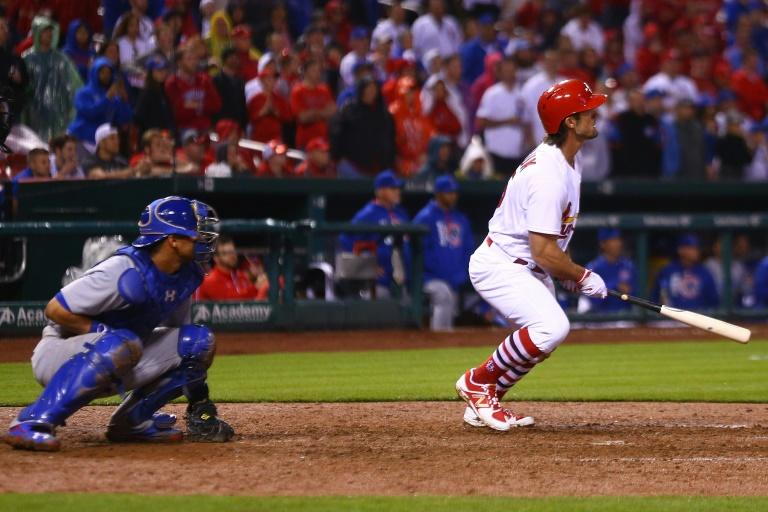 Randal Grichuk of the St. Louis Cardinals hits a walk-off single against the Chicago Cubs in the ninth inning during the 2017 MLB Opening Day, at Busch Stadium in St. Louis, Missouri, on April 2