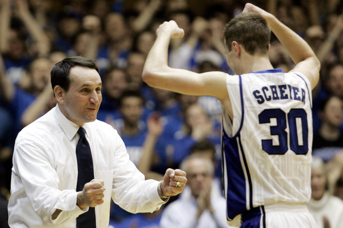 FILE- In this Feb. 22, 2009, file photo, Duke coach Mike Krzyzewski congratulates Jon Scheyer (30) late in the second half of an NCAA college basketball game against Wake Forest in Durham, N.C. Duke Hall of Fame coach Mike Krzyzewski will coach his final season with the Blue Devils in 2021-22, a person familiar with the situation said Wednesday, June 2, 2021. The person said former Duke player and associate head coach Jon Scheyer would then take over as Krzyzewski's successor for the 2022-23 season. (AP Photo/Gerry Broome, File)