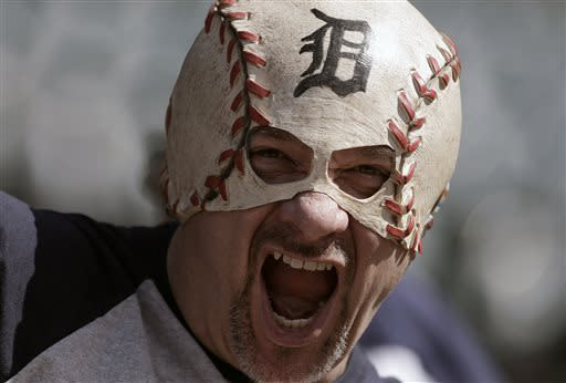 Al Crawford, of Warren, Mich., cheers during batting practice before an opening day baseball game between the New York Yankees and Detroit Tigers in Detroit, Friday April 5, 2013. (AP Photo/Paul Sancya)