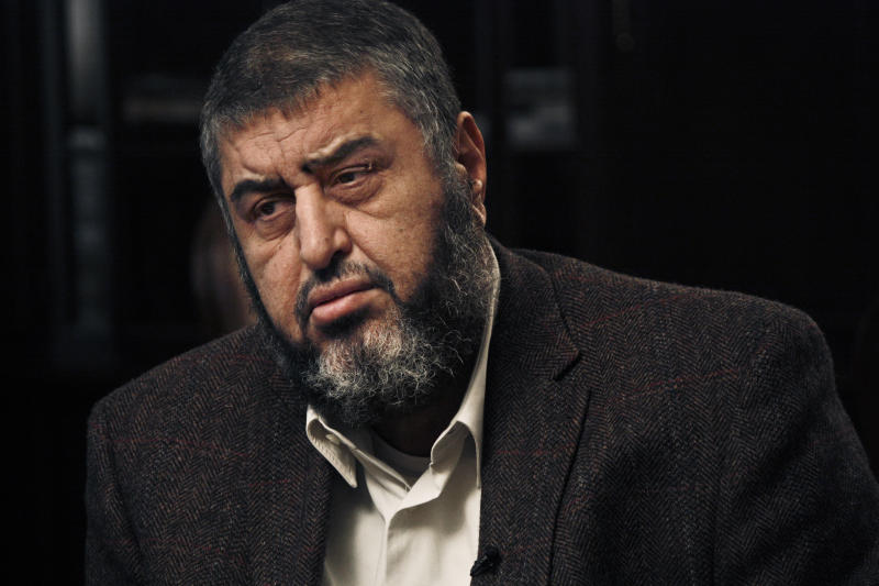 In this Tuesday, Jan. 24, 2012 photo, Muslim Brotherhood nominated deputy leader Khairat el-Shater, listens during an interview with the Associated Press in Cairo, Egypt. Egypt's official news agency says the Muslim Brotherhood's leader, Mohammed Badie and his powerful deputy, el-Shater will go on trial Aug 25 for their complicity in and incitement of the killing of eight protesters. (AP Photo/Nariman El-Mofty)