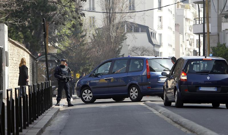 Cars with their registration plates covered with tape, transfer passengers believed to be Abdelkader Merah and his companion to the French police's anti-terrorist headquarters in Levallois-Perret, outside Paris, Saturday, March 24, 2012. Merah's brother, Mohamed Merah is blamed for a series of deadly shootings which have shocked France and upended the country's presidential race. Merah, who claimed allegiance to al-Qaida, died in a hail of gunfire Thursday after a dramatic 32-hour-long standoff with law enforcement. (AP Photo/Christophe Ena)