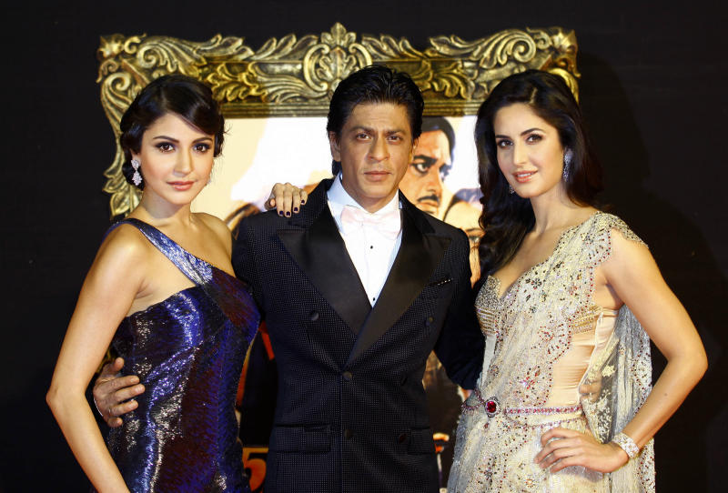 "In this Monday, Nov. 12, 2012 photo, Bollywood stars Anushka Sharma, left, Shah Rukh Khan, center, and Katrina Kaif pose during the premiere of their film ""Jab Tak Hai Jaan"" or ""As long as I Am Alive"" in Mumbai, India. Bollywood stars turned out in strength at the premiere of the movie for a final homage to movie mogul Yash Chopra, who died last month days after finishing the film. Chopra was known as the ""King of Romance"" for creating classic love stories that were immensely popular. (AP Photo/Rafiq Maqbool)"