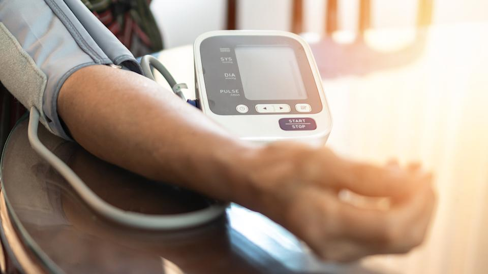 Elderly patient with bp, heart rate, digital pulse check equipment for medical geriatric awareness in stroke systolic high blood pressure, hypertension, hypotension and cardiovascular disease in aged senior older woman person