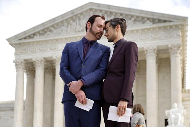 <p>David Mullins (L) and Charlie Craig wait to speak to journalists after the Supreme Court hear the case Masterpiece Cakeshop v. Colorado Civil Rights Commission, Dec. 5, 2017 in Washington. (Photo: Chip Somodevilla/Getty Images) </p>
