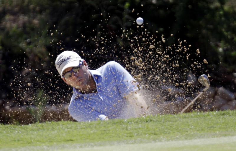 Ben Curtis hits from a sand bunker on the first hole during the third round of the Texas Open golf tournament, Saturday, April 21, 2012, in San Antonio. (AP Photo/Eric Gay)
