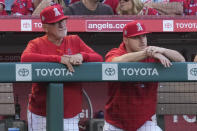 Los Angeles Angels manager Joe Maddon, left, and center fielder Mike Trout stand in the dugout during the third inning of a baseball game against the Baltimore Orioles Friday, July 2, 2021, in Anaheim. (AP Photo/Ashley Landis)