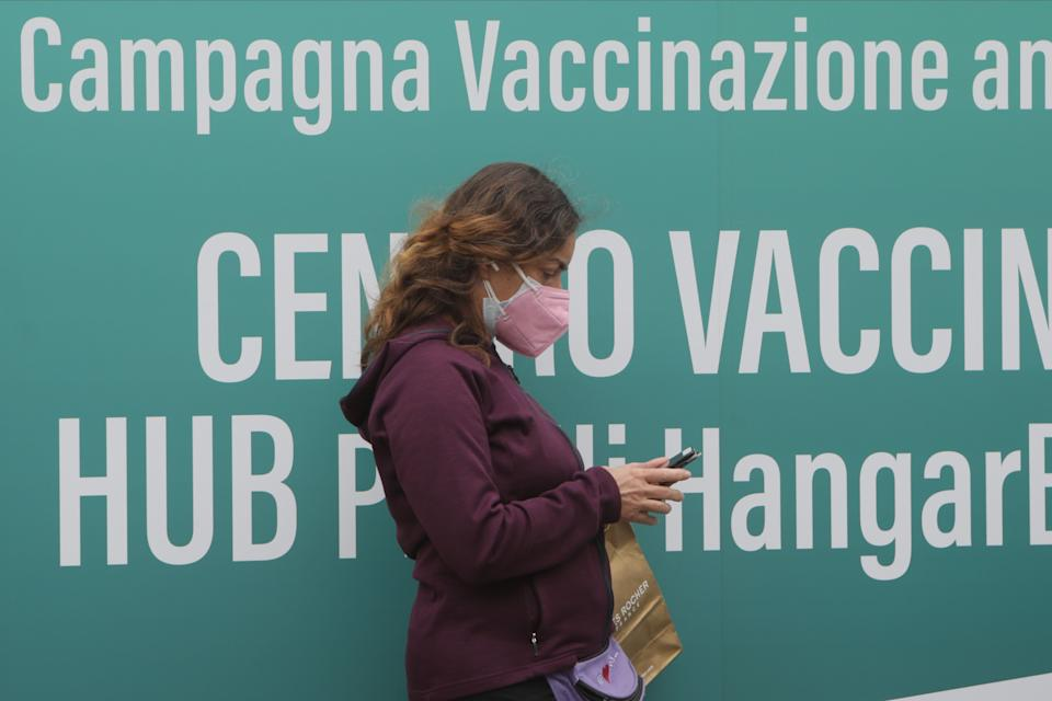 A woman wearing a protective mask attend inauguration of the Coronavirus vaccine center at Hangar Bicocca in Milan, Italy, on April 26 2021. (Photo by Mairo Cinquetti/NurPhoto via Getty Images) (Photo: NurPhoto via Getty Images)