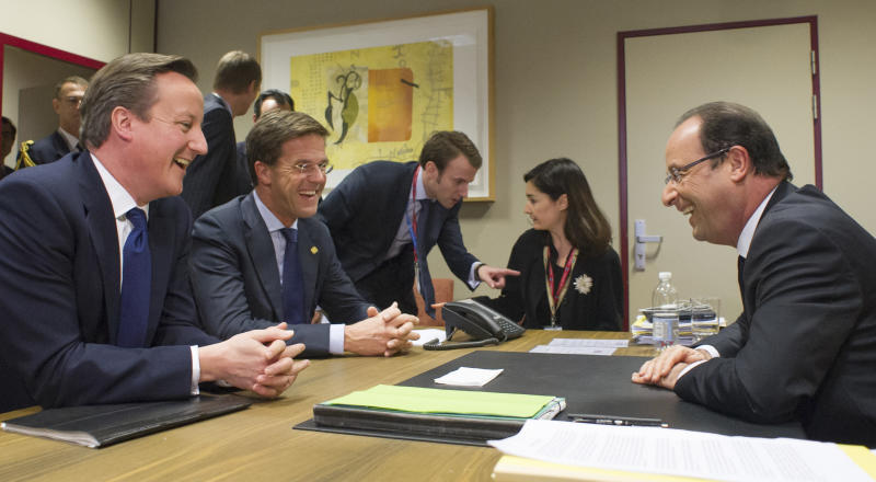 French President Francois Hollande, right, participates in a trilateral meeting with British Prime Minister David Cameron, left, and Dutch Prime Minister Mark Rutte, second left, on the sidelines of an EU summit in Brussels on Friday, Nov. 23, 2012. The prospect of failure hangs over a European Union leaders' summit intended to lay out the 27-country bloc's long-term spending plans. While heavyweights like Britain and France are pulling in opposite directions, smaller members are threatening to veto a deal to make themselves heard. (AP Photo/Bertrand Langlois, Pool)