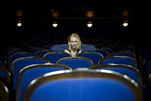 Soprano Henriikka Groendahl in the concert hall of the Stockholm folk opera. She and another soprano, four singers, one mezzo and a baritone who works with artist Joshua Sofaer to choose the arias proposed to people in need