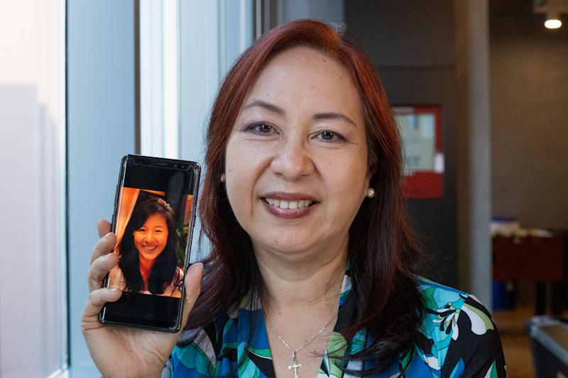 Agnes Tan, 61, holds up a photo of her late daughter Isabelle, 17, who passed in 2012 from brain cancer. PHOTO: Dhany Osman/Yahoo News Singapore