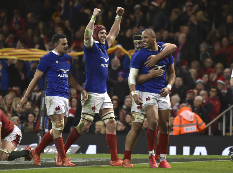 France's Gael Fickou, right, celebrates after scoring his try but it is disallowed for a forward pass during the Six Nations rugby union international between Wales and France at the Principality Stadium in Cardiff, Wales, Saturday, Feb. 22, 2020. (AP Photo/Rui Vieira)