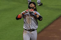 San Francisco Giants' Brandon Crawford runs the bases after hitting a solo home run during the seventh inning of a baseball game against the Cincinnati Reds in Cincinnati, Tuesday, May 18, 2021. (AP Photo/Aaron Doster)
