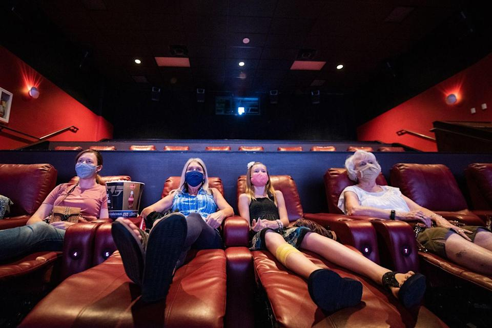 <p>Movie goers watch a film at the AMC Highlands Ranch 24 on August 20 in Highlands Ranch, Colorado.</p>