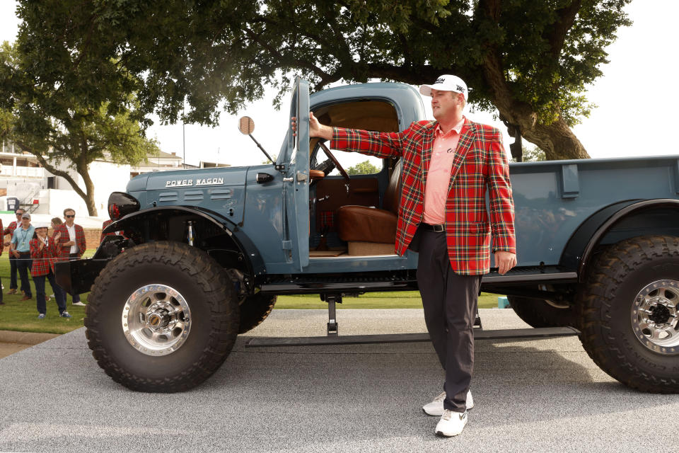 Jason Kokrak gets out of his 1946 Power Wagon that he received after winning the Charles Schwab Challenge golf tournament at the Colonial Country Club in Fort Worth, Texas Sunday, May 30, 2021. (AP Photo/Michael Ainsworth)