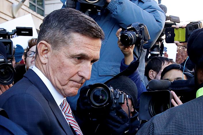 Former U.S. national security adviser Michael Flynn passes by members of the media as he departs after his sentencing was delayed at U.S. District Court in Washington, U.S., December 18, 2018.  REUTERS/Joshua Roberts     TPX IMAGES OF THE DAY