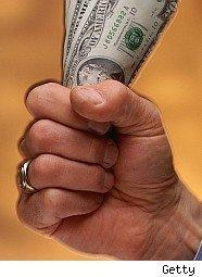 Man holding wad of cash in his hand