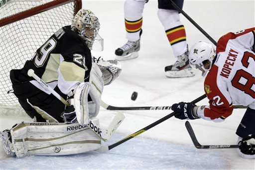 Pittsburgh Penguins goalie Marc-Andre Fleury (29) blocks a shot by Florida Panthers' Tomas Kopecky (82) during the first period of an NHL hockey game in Pittsburgh on Friday, March 9, 2012. (AP Photo/Gene J. Puskar)