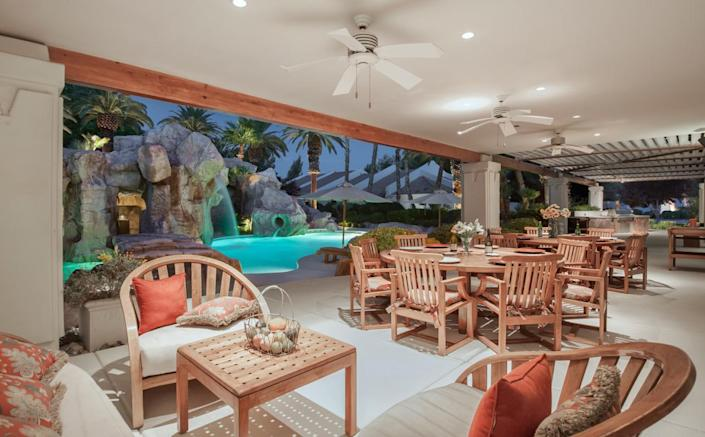 """<p>A spacious indoor/outdoor patio merges into the unique pool area. (All photos via <a href=""""http://bit.ly/1OjQdjg"""" rel=""""nofollow noopener"""" target=""""_blank"""" data-ylk=""""slk:Concierge Auctions listing"""" class=""""link rapid-noclick-resp"""">Concierge Auctions listing</a>)</p>"""