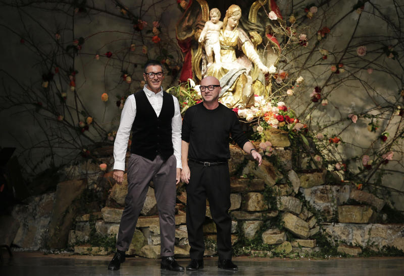 FILE -- In this file photo taken on Jan. 12, 2013, Italian fashion designers Stefano Gabbana, left, and Domenico Dolce bow to the audience after presenting their Dolce & Gabbana men's Fall-Winter 2013-14 collection in Milan, Italy. A Milan court convicted fashion designers Domenico Dolce and Stefano Gabbana of tax evasion. The pair were found guilty Wednesday of failing to declare euros 1 billion ($1.3 billion) in income to authorities. The court sentenced them both to one year and eight months in jail. Prosecutors argued that the pair had evaded taxes on income of 416 million euros each and 200 million euros through a Luxembourg-based company. The statute of limitations ran out on a charge of misrepresenting income. (AP Photo/Antonio Calanni)