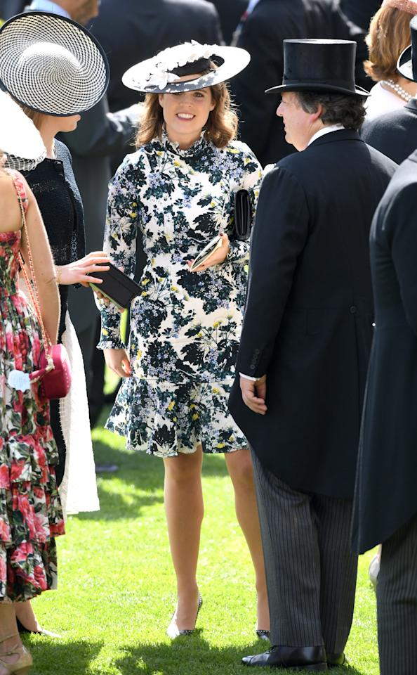 <p>Princess Eugenie is a big fan of floral numbers and she showed up at day three of Ascot rocking a pretty long-sleeved dress with a matching halo hat. Photo: Getty Images </p>
