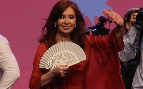<span>Former President Cristina Fernandez de Kirchner and running mate of presidential candidate Alberto Fernandez celebrates after election results in Buenos Aires</span> <span>Credit: Reuters </span>
