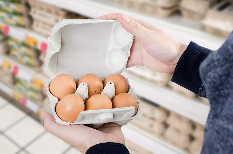 Man buys eggs in the supermarket. Egg store supermarket price expensive grocery shop concept