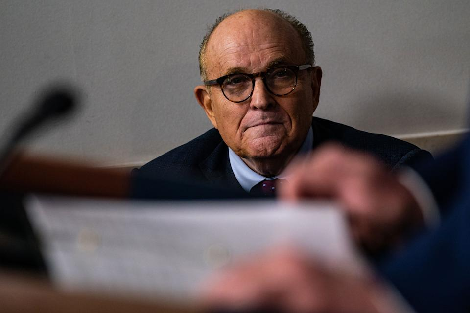 "Rudy Giuliani listens as President Trump speaks during a news briefing at the White House in Washington, D.C., on Sept. 27, 2020.<span class=""copyright"">Salwan Georges—The Washington Post/Getty Images</span>"