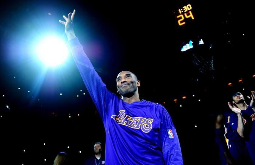 Kobe Bryant waves to the crowd as he is introduced before a game against the Thunder in Oklahoma City on April 11.