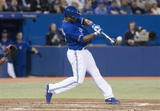 Toronto Blue Jays' Edwin Encarnacion hits a three-run home run off Cleveland Indians' Brett Myers during the fifth inning of a baseball game in Toronto on Thursday, April 4, 2013. (AP Photo/The Canadian Press, Chris Young)