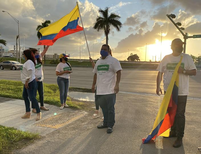 Colombian Americans gather along the soon-to-be-renamed street, Alvaro Uribe Way.