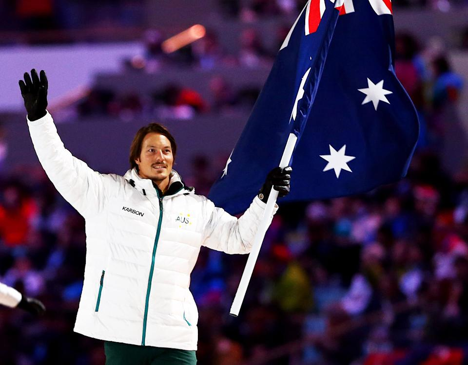 Alex 'Chumpy' Pullin, pictured here carrying the Australian flag at the Opening Ceremony of the 2014 Winter Olympics in Sochi.