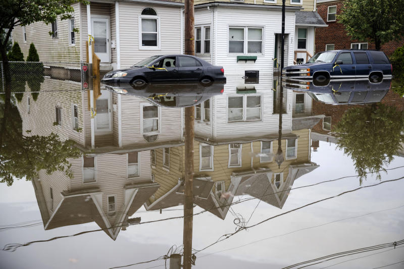 Floodwaters partially submerge vehicles on Broadway in Westville, N.J. Thursday, June 20, 2019. Severe storms containing heavy rains and strong winds spurred flooding across southern New Jersey, disrupting travel and damaging some property. (Photo: Matt Rourke/AP)