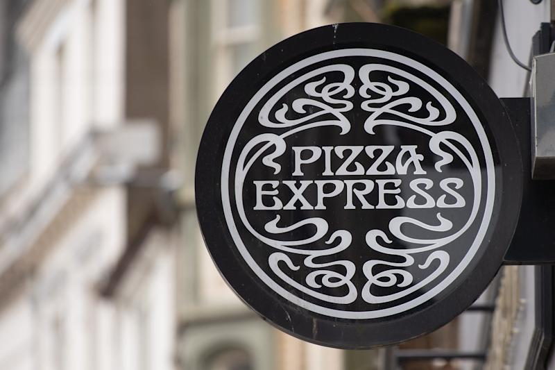 CARDIFF, WALES - JULY 27: A close-up of a Pizza Express restaurant sign on July 27, 2020 in Cardiff, Wales. Many UK businesses are announcing job losses due to the effects of the coronavirus pandemic and lockdown. (Photo by Matthew Horwood/Getty Images)