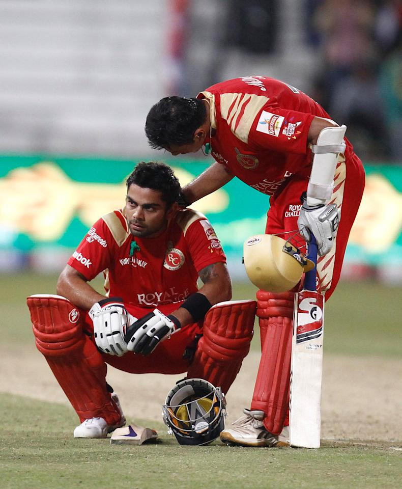 DURBAN, SOUTH AFRICA - SEPTEMBER 19: Rahul Dravid (R) consols team mate Virat Kohli of the Royal Challengers Bangalore during the Airtel Champions League Twenty20 match between Mumbai Indians and Royal Challengers Bangalore at Sahara Stadium Kingsmead on September 19, 2010 in Durban, South Africa. (Photo by Anesh Debiky/Gallo Images/Getty Images)