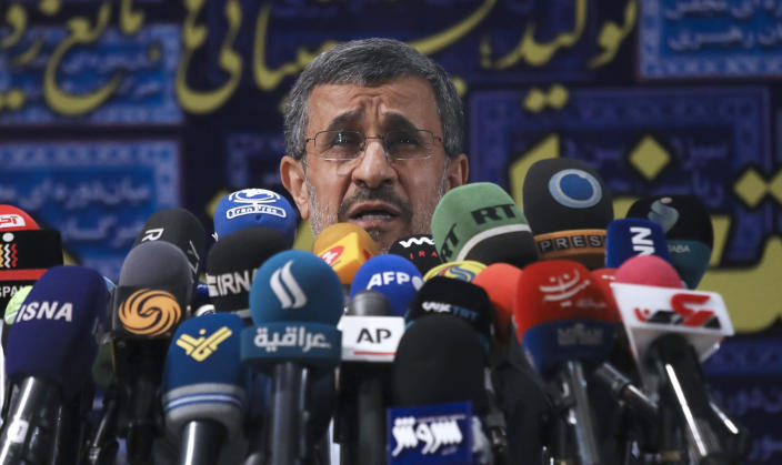 Former President Mahmoud Ahmadinejad speaks with the media after registering his name as a candidate for the June 18 presidential elections at elections headquarters of the Interior Ministry in Tehran, Iran, Wednesday, May 12, 2021. The country's former firebrand president will run again for office in upcoming elections in June. The Holocaust-denying Ahmadinejad has previously been banned from running for the presidency by Supreme Leader Ayatollah Ali Khamenei in 2017, although then, he registered anyway. (AP Photo/Vahid Salemi)