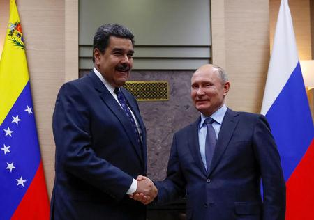 Putin shakes hands with his Venezuelan counterpart Nicolas Maduro during a meeting at the Novo Ogaryovo state residence outside Moscow Russia