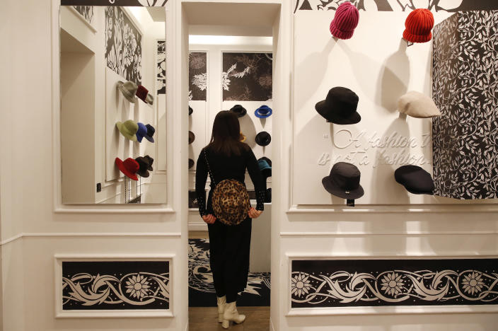 A girl wears a creation as part of the Borsalino women's Fall Winter 2021-22 collection, unveiled during the Fashion Week in Milan, Italy, Wednesday, Feb. 24, 2021. (AP Photo/Antonio Calanni)